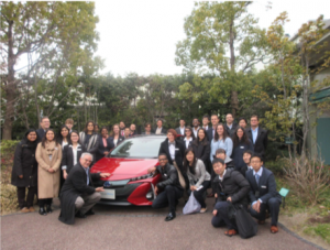 IDJ students around Toyota car