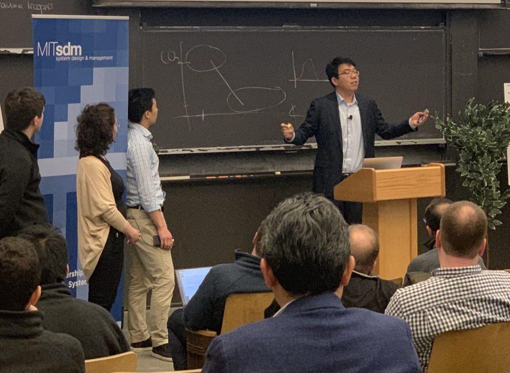 Keran Rong explains his team's presentation.
