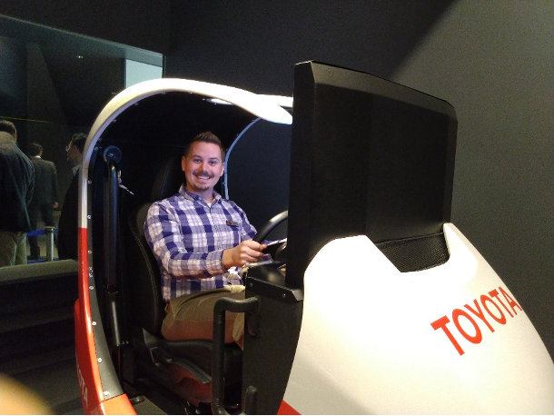 SDM student Brendan Horton sits in a simulation driving pod with the Toyota logo on the front